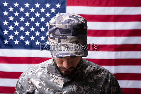 soldier in front of us flag