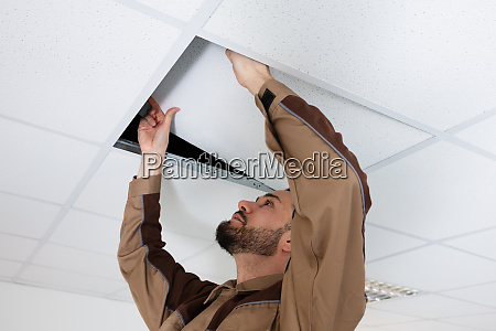 electrician installing ceiling