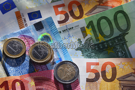 composition with euro banknotes and coins