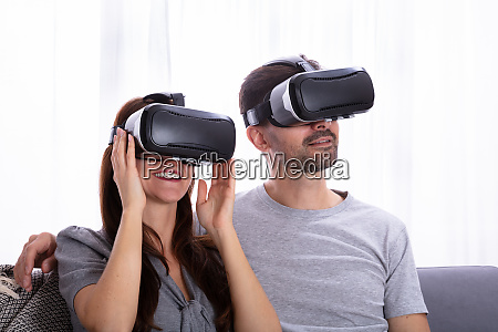 couple experiencing virtual reality headset