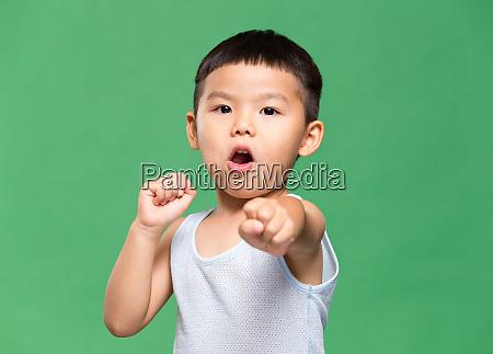 asian little boy fighting punch