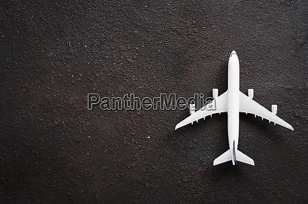 miniature airplane on a dark background