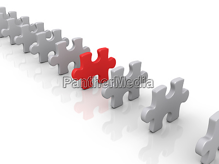 puzzle pieces and a different one