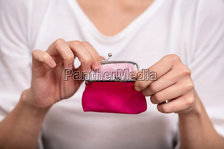 person holding pink purse