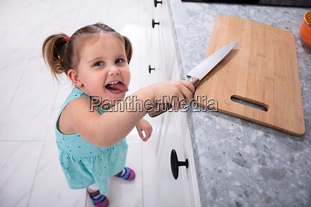 girl taking kitchen knife