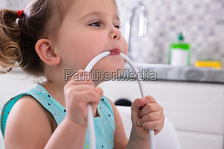 girl biting cable