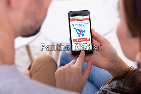 couple using online shopping application on