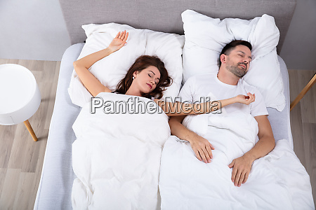 married couple napping on bed