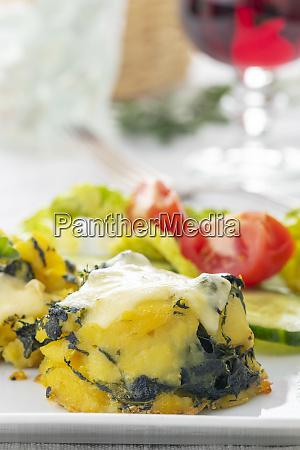 closeup of a spinach potato gratin