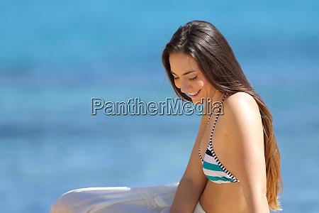 candid woman in bikini sitting on