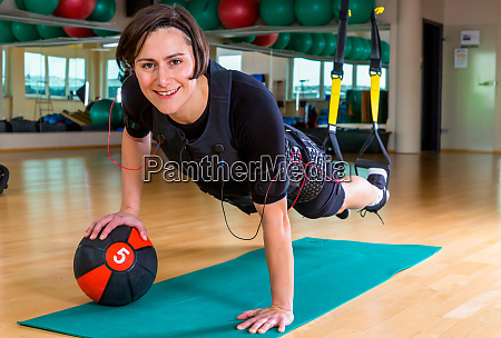 girl exercising with medicine ball and