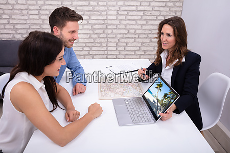 travel agent giving information to a