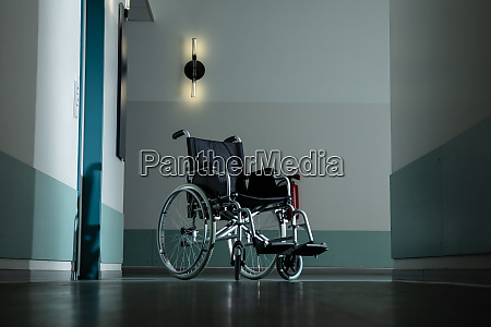 empty wheel chair in hospital corridor