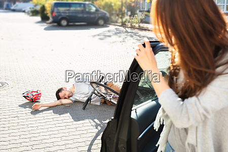 young woman looking at unconscious male