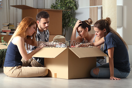 sad evicted roommates moving home boxing