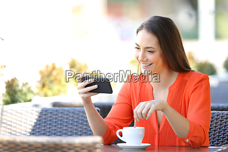 happy woman watching videos on phone