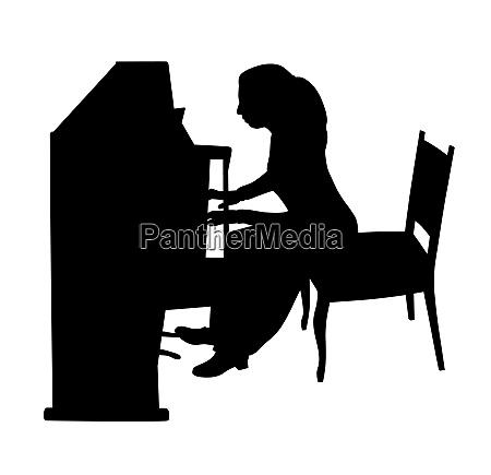 woman playing upright piano