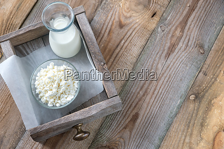 bowl of cottage cheese with bottle
