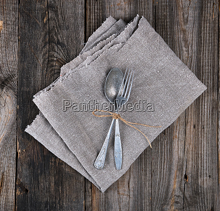 old metal fork and spoon tied