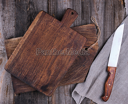 two old wooden cutting boards and