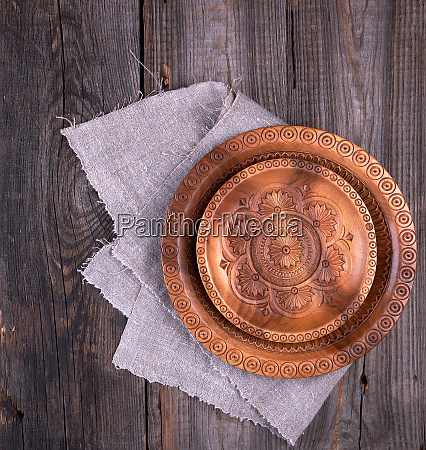 empty round brown carved decorative plate