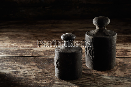 two old antique metal kilogram weights