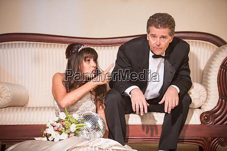 upset bride pointing at hapless husband