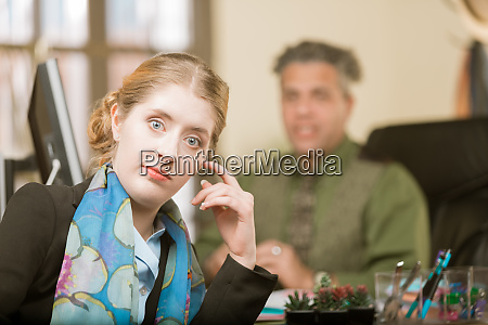 young woman reacting to clueless colleague