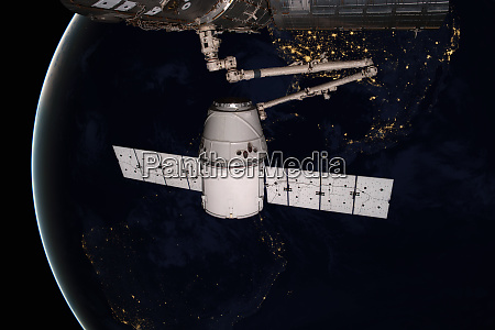 spacex dragon orbiting the planet earth