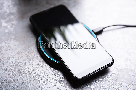 wireless charging pad and smartphone on