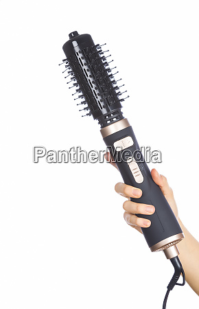 hand holding hair curling iron round