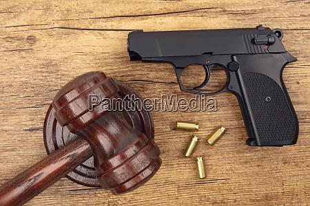 black pistol with ammunition