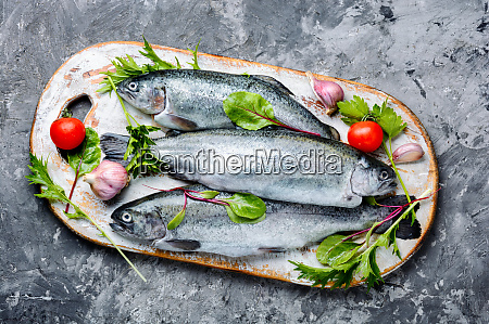 raw trout on cutting board