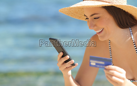 tourist paying with credit card and