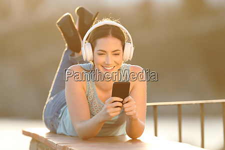 happy girl listens to music browsing