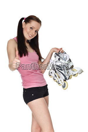 young sporty woman with rollerskates