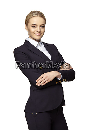 young blonde businesswoman stands with crossed