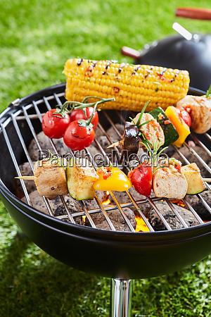 grilling vegetables and meat kebabs