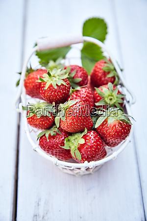 rustic basket full of fresh strawberries