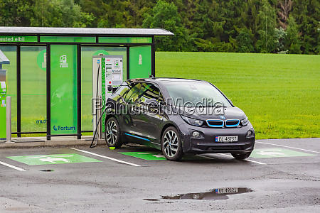 electric car at charging station on