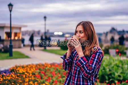 beautiful young woman drinking coffee