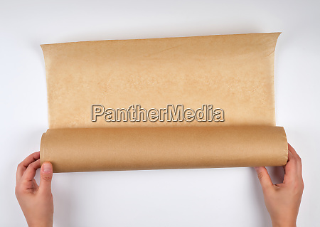 two hands hold a large roll