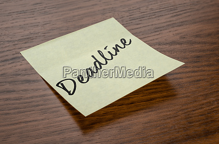 sticky note with the text deadline