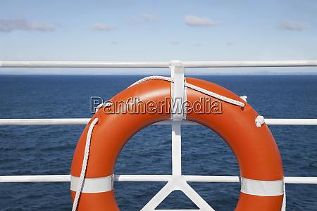 lifebuoy and cruise railing deck