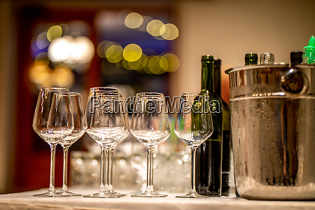 wine glasses bottles and ice bucket