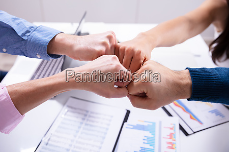businesspeople making fist bump