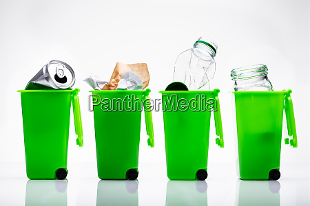 green recycle bins with used bottle