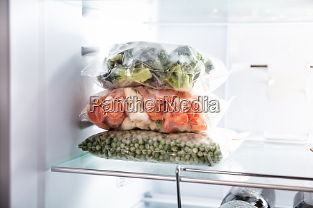 plastic bags with frozen vegetables in