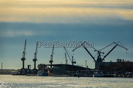 cranes ships and buildings in warnemuende