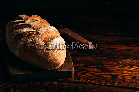 rye loaf on cutting board with